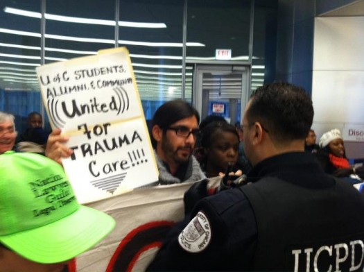 Alex peacefully protesting of U of Chicago Hospital. Subsequently arrested.