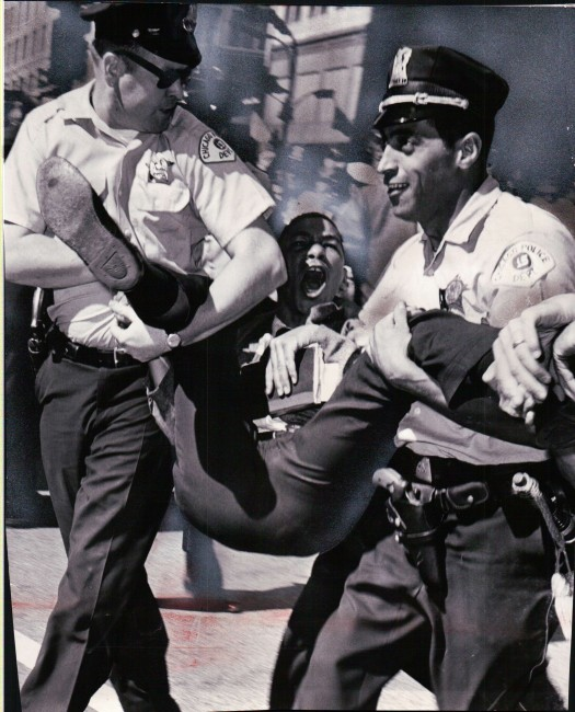 Newswire photograph from my collection. Demonstrator is removed by two police officers during a protest in Chicago at State & Madison (6/13/1965)