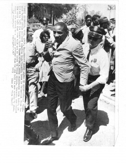 Dick Gregory in Greenwood, Miss, April 2, 1963 getting pushed by police after a voter registration protest.