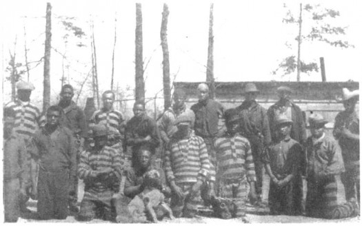 A group of negro prisoners showing stripes and chains. (1927) Source: The North Carolina chain gang; a study of county convict road work, by Jesse F. Steiner, and Roy M. Brown.