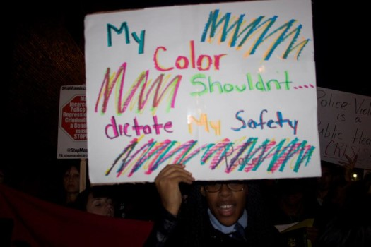 silent protest at 11th district (photo by We Get Free, 10/22/14)